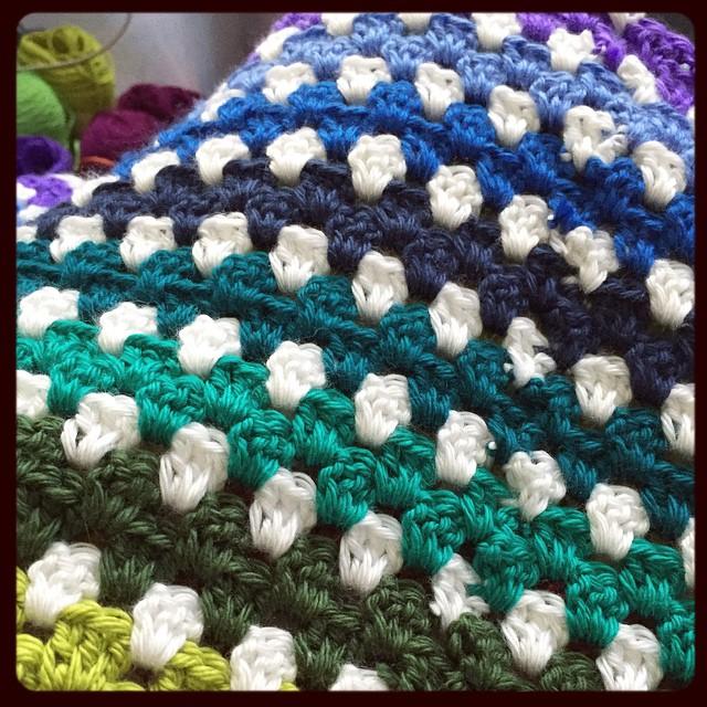 Greens, blues and now onto purples! #blanket #crochet #grannysquare #rainbow